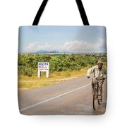 Man On Bicycle In Zambia Tote Bag