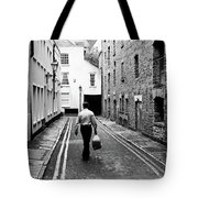 Man Walking With Shopping Bag Down Narrow English Street Tote Bag