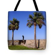 Man With A Hat On The Wall With Palm Trees In Saint Augustine Fl Tote Bag