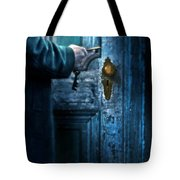 Man With Keys At Door Tote Bag