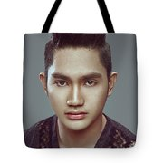 Man With Modern Bun Hairstyle In Black Shirt Tote Bag