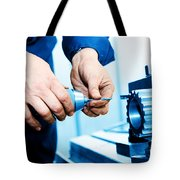 Man Working On Drilling And Boring Machine Tote Bag