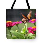 Monarch Approaching Zinnia Tote Bag