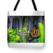 Monarch Butterfly Poised On Green Stem Among Yellow Flowers Tote Bag