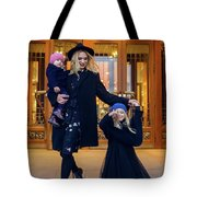 Mother With Two Daughters Standing Next To The Store In The Evening On The Street Tote Bag
