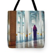 Muslim Woman Dressed In The Traditional Islam Clothing Standing Inside National Mosque In Malaysia Tote Bag