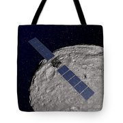 Nasas Dawn Spacecraft Orbiting Tote Bag