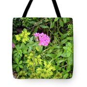 Natural Background With Vegetation And Purple Flowers. Tote Bag