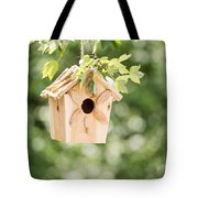New Wooden Birdhouse Hanging On Tree Branch Outdoors  Tote Bag
