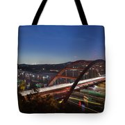 Nighttime Boats Leave Colorful Streaks As They Cruise Up And Down Lake Austin Below The 360 Pennybacker Bridge Tote Bag