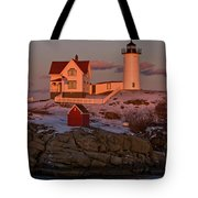Nubble Light At Sunset Tote Bag by Paul Mangold