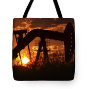 Oil Rig Pump Jack Silhouetted By Setting Sun Tote Bag