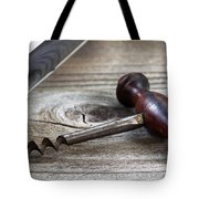 Old Corkscrew And Wine Bottle In Background On Rustic Wood Tote Bag