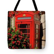 Old Red Telephone Box Or Booth Surrounded By Red Flowers In Toro Tote Bag
