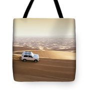 One 4x4 Vehicle Off-roading In The Red Sand Dunes Of Dubai Emirates, United Arab Emirates Tote Bag