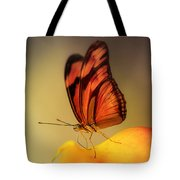 Orange And Black Butterfly Sitting On The Yellow Petal Tote Bag