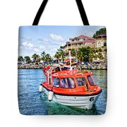Orange Lifeboats Across Colorful Bay Tote Bag