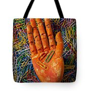 Orange Wooden Hand Holding Paperclips Tote Bag