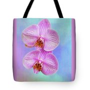 Orchid Delight - Two Blooms Against A Rainbow Background Tote Bag