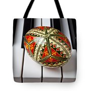 Painted Easter Egg On Piano Keys Tote Bag