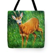 painting of young deer in wild landscape with high grass. Eye contact. Tote Bag