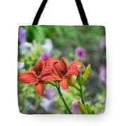 Pair Of Red Asiatic Lilies After A Rain Tote Bag