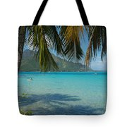 Palm Trees Cast A Shadow In Blue Water Tote Bag