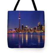 Panorama Of Frozen Ice Covered Lake Ontario Reflecting The Light Tote Bag