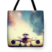 Passenger Airplane Taking Off On Runway At Sunset Tote Bag