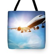 Passenger Airplane Taking Off, Sunny Blue Sky. Tote Bag
