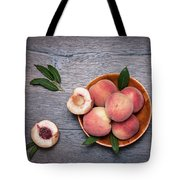 Peaches On A Dark Wooden Background Tote Bag