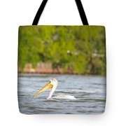 Pelican Drifting Along Tote Bag