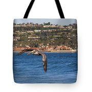 Pelican Flying Above The Pacific Ocean Tote Bag