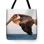 Pelican In Flight At Sunset Tote Bag