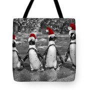 Penguins With Santa Claus Caps Tote Bag