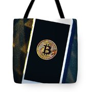 Phone With A Bitcoin Laying On Top Of It. Tote Bag
