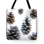 Pine Cones Looking Like Christmas Trees On White Snowy Backgroun Tote Bag