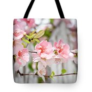 Pink Flowers And A White Picket Fence Tote Bag