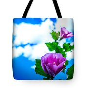 Pink Flowers On A Blue Sky Tote Bag