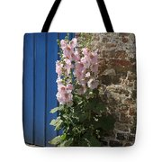 Pink Hollyhocks Growing From A Crack In The Pavement Tote Bag