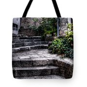 Plants Grow In The Uneven Stairs Climbing Towards The Tower Tote Bag