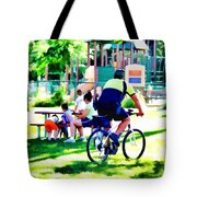 Police Officer Rides A Bicycle Tote Bag