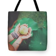 Portrait Of A Girl Holding Gently A Lotus Flower In Her Hands Tote Bag
