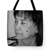 Portrait Of An Attractive Filipina Woman With A Mole On Her Cheek Tote Bag