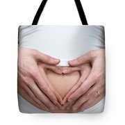Pregnant Woman With Hands Making Heart Shape On Her Belly Tote Bag