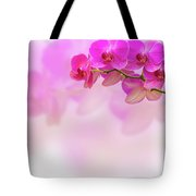 Purple Orchid Flower On Blur Background Tote Bag