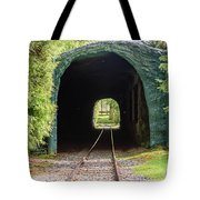 The Railway Passing Through The Tunnel To Meet The Light Tote Bag