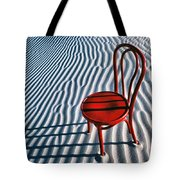 Red Chair In Sand Tote Bag