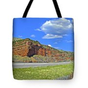Red Cliffs And White Clouds Over Interstate 80 Rest Stop In Utah  Tote Bag