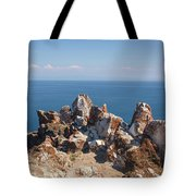 Red Rocks On Blue Sky And Water Background Tote Bag by Sergey Taran